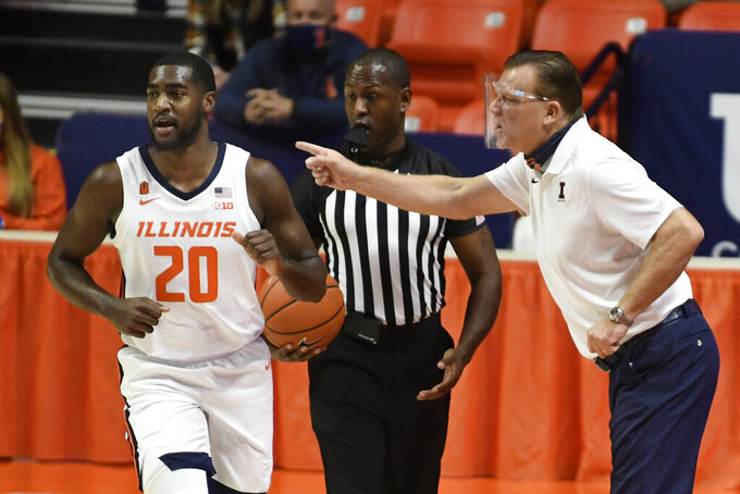 Illinois head coach Brad Underwood gives directions to Da'Monte Williams in the first half of an NCAA college basketball game against North Carolina A&T, Wednesday, Nov. 25, 2020, in Champaign, Ill. (Photo/Holly Hart)