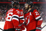 New Jersey Devils defenseman P.K. Subban (76) congratulates right wing Kyle Palmieri (21) after Palmieri scored against the Columbus Blue Jackets during the second period of an NHL hockey game Sunday, Feb. 16, 2020, in Newark, N.J. (AP Photo/Kathy Willens)