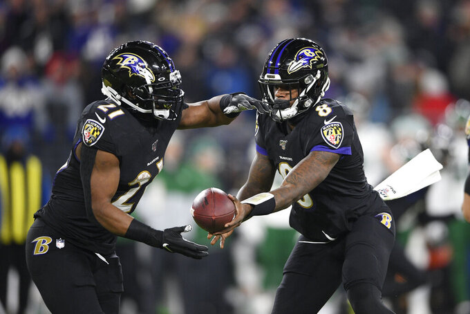 "File-This Dec. 12, 2019, file photo shows Baltimore Ravens quarterback Lamar Jackson (8) handing off to running back Mark Ingram (21) during the first half of an NFL football game against the New York Jets in Baltimore. As he draws closer to a milestone birthday,  Ingram wants everyone to know he's still got what it takes to score a bunch of touchdowns, rush for 1,000 yards and earn an invite to the Pro Bowl. ""I feel like people say when you're 30 you're dead,"" Ingram said Wednesday. ""I turn 30 at the end of this week, but my best football is ahead of me.""  (AP Photo/Nick Wass, File)"