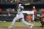 Tampa Bay Rays' Randy Arozarena follows through on a two-run home run against the Baltimore Orioles during the eighth inning of baseball game Saturday, Aug. 28, 2021, in Baltimore. The Rays won 4-3. (AP Photo/Gail Burton)