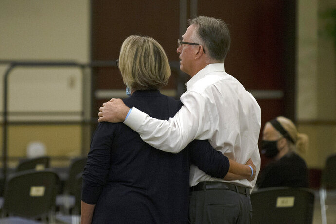 Gay and Bob Hardwick who were attacked in their Stockton home in 1978 by Golden State Killer, Joseph James DeAngelo, stand as the charges are read against DeAngelo during a hearing in Sacramento Superior Court in Sacramento, Calif. Monday June 29, 2020. DeAngelo, 74, pleaded guilty to 13 counts of murder and multiple other charges 40 years after a sadistic series of assaults and slayings in California. (AP Photo/Rich Pedroncelli)