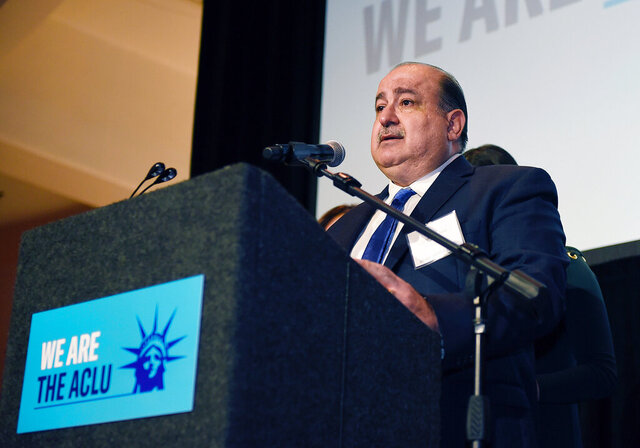 """In this Nov. 9, 2018, photo provided by the American Civil Liberties Union, Usama """"Sam"""" Hamama appears at an American Civil Liberties Union event in Dearborn, Mich. Hamama, a Detroit-area man who was locked up for months and became the lead plaintiff in a class-action lawsuit challenging U.S. deportations to Iraq, has won his immigration case and is on a path to citizenship, lawyers said Wednesday, Jan. 15, 2020. (Clarence Tabb Jr./In My Eye Photography/American Civil Liberties Union via AP)"""