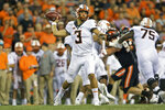 FILE - In this Aug. 30, 2019, file photo, Oklahoma State quarterback Spencer Sanders passes against Oregon State during an NCAA football game in Corvallis, Ore. He wasn't named the starter until right before kickoff, but after a winning a lengthy battle with Hawaii grad transfer Dru Brown to take over as Oklahoma State's quarterback, redshirt freshman Spencer Sanders enjoyed an impressive debut in the Cowboys' 52-36 victory over Oregon State Friday night. (AP Photo/Craig Mitchelldyer, FIle)