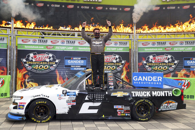NASCAR Texas Trucks Series driver Sheldon Creed (2) celebrates in Victory Lane after winning an auto race at Texas Motor Speedway in Fort Worth, Texas, Sunday, Oct. 25, 2020. (AP Photo/Richard W. Rodriguez)