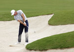 Britain's Paul Casey plays from a bunker on the 5th hole during the second round of the Australian Open golf tournament in Sydney, Friday, Dec. 6, 2019. (AP Photo/Rick Rycroft)