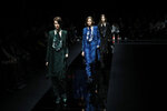 Models wear creations part of Emporio Armani's Fall/Winter 2020/2021 collection, presented in Milan, Italy, Friday, Feb. 21, 2020. (AP Photo/Antonio Calanni)