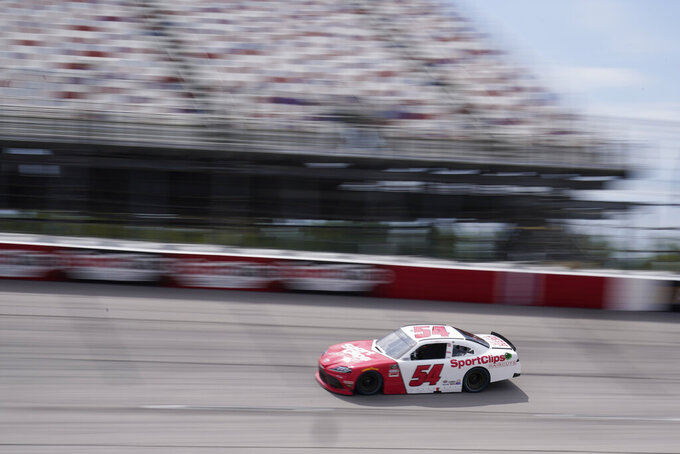 Denny Hamlin (54) moves during a NASCAR Xfinity Series auto race Saturday, Sept. 5, 2020, in Darlington, S.C. (AP Photo/Chris Carlson)