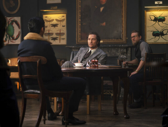 This image released by STXfilms shows, from left, Henry Golding, Matthew McConaughey and Charlie Hunnam in a scene from