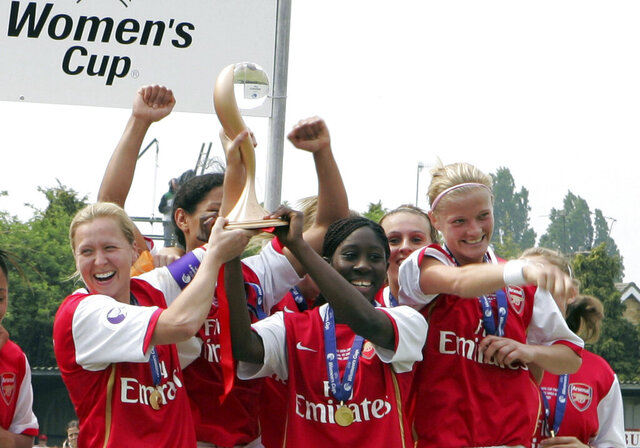 FILE - In this Sunday, April 29, 2007 file photo, Arsenal Ladies celebrate with the trophy after beating Umea IK 1-0 on aggregate during their Women's Cup final second leg soccer match at the Meadow Park stadium, London. For Arsenal, this year's Women's Champions League win-or-go-home tournament is more like win or stay home because the truncated English season has left the team out next season's competition. The seven other teams in the knockout tournament scheduled to begin Friday, Aug. 21, 2020 in Spain's northern Basque Country have already qualified for next season's Champions League. Arsenal needs to win it to get back into it. (AP Photo/Tom Hevezi, File)