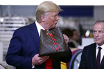 President Donald Trump tours the Louis Vuitton Workshop Rochambeau in Alvarado, Texas, Thursday, Oct. 17, 2019. (AP Photo/Andrew Harnik)