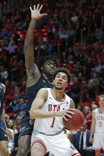 Washington forward Isaiah Stewart, rear, guards Utah forward Timmy Allen (1) in the second half during an NCAA college basketball game Thursday, Jan. 23, 2020, in Salt Lake City. (AP Photo/Rick Bowmer)