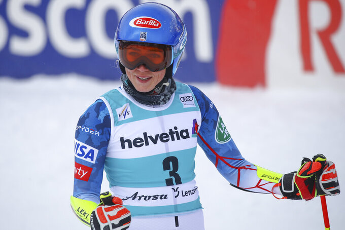 United States' Mikaela Shiffrin gets to the finish area after completing the first run of an alpine ski, women's World Cup giant slalom, in Lenzerheide, Switzerland, Sunday, March 21, 2021. (AP Photo/Marco Trovati)