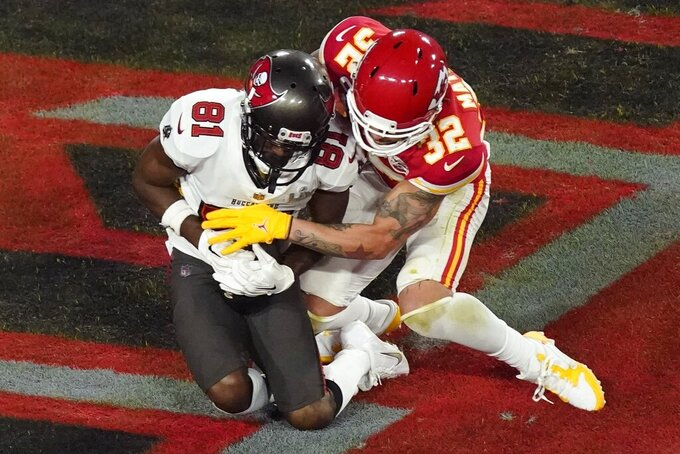 Tampa Bay Buccaneers' Antonio Brown (81) makes a touchdown reception against Kansas City Chiefs' Tyrann Mathieu (32) during the first half of the NFL Super Bowl 55 football game Sunday, Feb. 7, 2021, in Tampa, Fla. (AP Photo/Charlie Riedel)