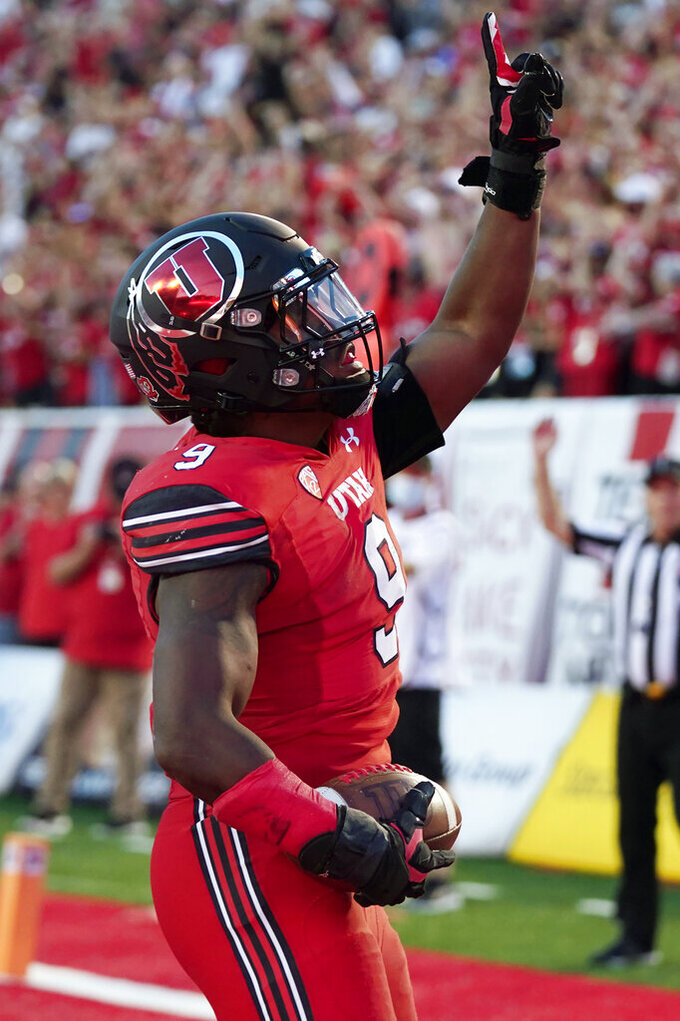 Utah running back Tavion Thomas celebrates a first-half touchdown against Weber State during an NCAA college football game Thursday, Sept. 2, 2021, in Salt Lake City. (AP Photo/Rick Bowmer)