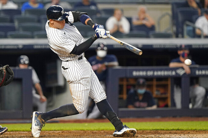 New York Yankees designated hitter Aaron Judge grounds into an RBI fielder's choice during the fourth inning of a baseball game against the Boston Red Sox, Sunday, June 6, 2021, at Yankee Stadium in New York. The Yankees' Miguel Andujar scored on the play. (AP Photo/Kathy Willens)