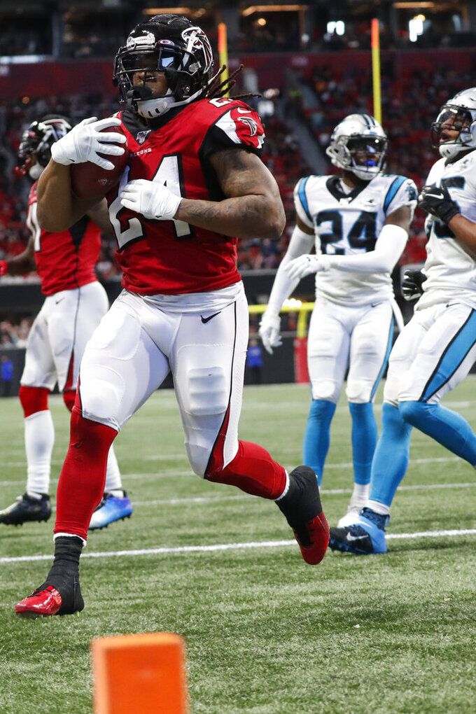 Atlanta Falcons running back Devonta Freeman (24) runs into the end zone for a touchdown against the Carolina Panthers during the second half of an NFL football game, Sunday, Dec. 8, 2019, in Atlanta. (AP Photo/John Bazemore)