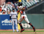 San Francisco Giants' Mauricio Dubon runs the bases after hitting a solo home run against the Miami Marlins in the third inning of a baseball game in San Francisco, Sunday, Sept. 15, 2019. (AP Photo/John Hefti)