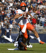 Illinois quarterback Brandon Peters (18) breaks free from Connecticut defensive back Tyler Coyle (25) during the first half of an NCAA college football game, Saturday, Sept. 7, 2019, in East Hartford, Conn. (AP Photo/Jessica Hill)