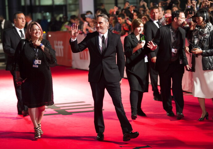 Actor Joaquin Phoenix arrives on the red carpet for the premiere of the film