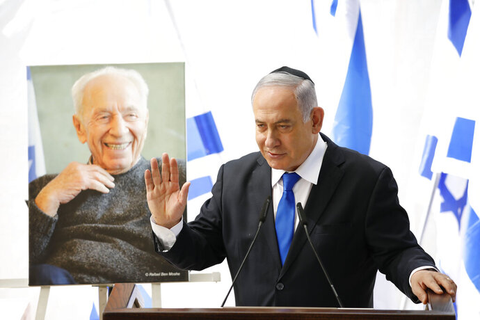 Israeli Prime Minister Benjamin Netanyahu speaks during a memorial service for former President Shimon Peres in Jerusalem, Thursday, Sept. 19, 2019. Israelis are contending with the prospect of a third election, two days after an unprecedented repeat election left the country's two main political parties deadlocked, with neither Prime Minister Benjamin Netanyahu nor his rivals holding a clear path to a coalition government. (AP Photo/Ariel Schalit)