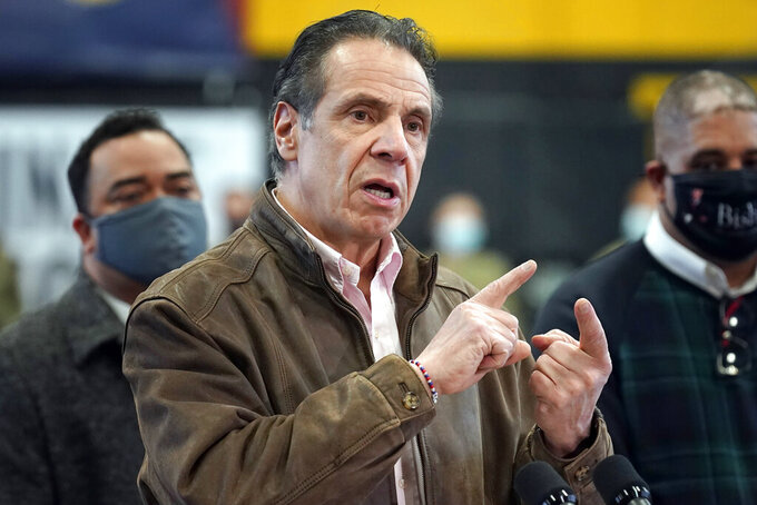 FILE — In this Feb. 22, 2021 file photo, New York Gov. Andrew Cuomo speaks during a news conference at a COVID-19 vaccination site in the Brooklyn borough of New York. New York's attorney general said she's moving forward with an investigation into sexual harassment allegations against Gov. Andrew Cuomo after receiving a letter from his office Monday, March 1, 2021, authorizing her to take charge of the probe. (AP Photo/Seth Wenig, Pool, File)