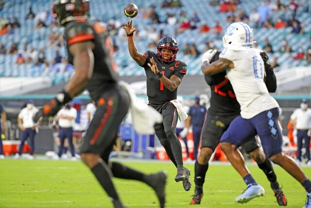 Miami quarterback D'Eriq King (1) throws a touchdown pass to wide receiver Mike Harley (3) during the first half of an during an NCAA college football game against North Carolina at Hard Rock Stadium In Miami Gardens, Fla, Saturday, Dec, 12, 2020. (Al Diaz/Miami Herald via AP)