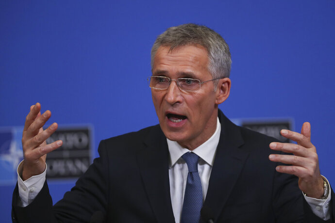 NATO's Secretary General Jens Stoltenberg gestures during a news conference at NATO headquarters in Brussels, Tuesday, Feb. 12, 2019. (AP Photo/Francisco Seco)