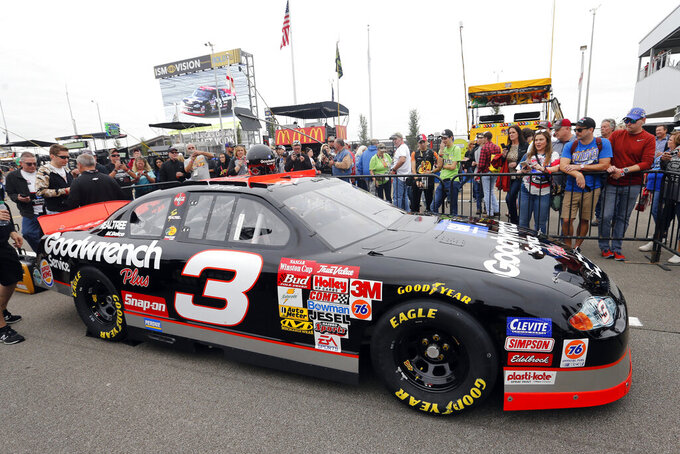 The No. 3 car of the late NASCAR driver Dale Earnhardt Sr. sits on pit road before a NASCAR Cup Series auto race at Talladega Superspeedway, Sunday, Oct. 13, 2019, in Talladega, Ala. (AP Photo/Butch Dill)