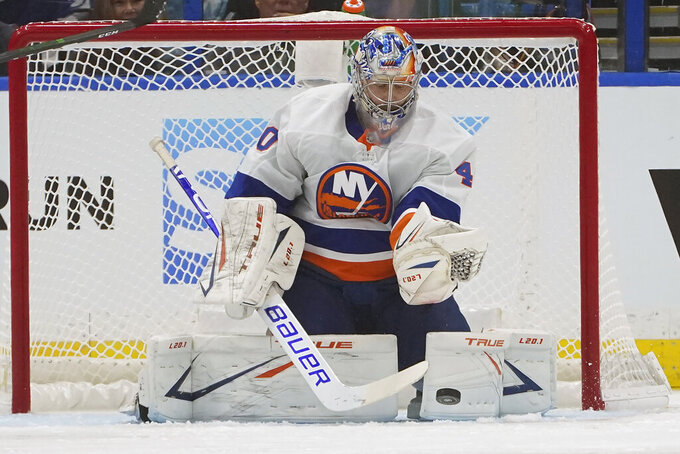 New York Islanders goaltender Semyon Varlamov (40) makes a save on a shot by the Tampa Bay Lightning during the first period in Game 1 of an NHL hockey Stanley Cup semifinal playoff series Sunday, June 13, 2021, in Tampa, Fla. (AP Photo/Chris O'Meara)
