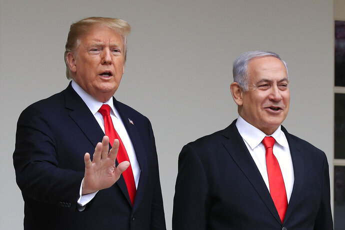 FILE - In this March 25, 2019, file photo, President Donald Trump welcomes visiting Israeli Prime Minister Benjamin Netanyahu to the White House in Washington. Trump is holding back-to-back meetings with Israeli Prime Minister Benjamin Netanyahu and his chief challenger ahead of the unveiling of the U.S. administration's much-anticipated plan to resolve the Israeli-Palestinian conflict. The meetings come just a month before Netanyahu and Benny Gantz are set to face off in national elections for the third time in less than a year.  (AP Photo/Manuel Balce Ceneta, File)