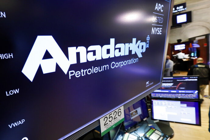FILE - In this April 12, 2019, file photo the logo for Anadarko Petroleum Corp. appears above a trading post on the floor of the New York Stock Exchange. The overall slowdown in deals during the first quarter could be a prelude to a spike in deals for the rest of 2019. Several large deals have already been announced in the second quarter. Chevron is buying Anadarko Petroleum for $33 billion. (AP Photo/Richard Drew, File)