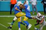 Miami Dolphins outside linebacker Andrew Van Ginkel (43) blocks a punt by Los Angeles Chargers punter Ty Long (1), during the first half of an NFL football game, Sunday, Nov. 15, 2020, in Miami Gardens, Fla. (AP Photo/Wilfredo Lee)