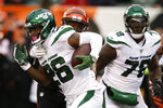 New York Jets running back Le'Veon Bell (26) runs the ball against Cincinnati Bengals linebacker Germaine Pratt, center, during the first half of an NFL football game, Sunday, Dec. 1, 2019, in Cincinnati. (AP Photo/Gary Landers)
