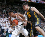 Michigan State's Xavier Tillman, left, and Iowa's Luka Garza fight for a rebound during the first half of an NCAA college basketball game, Tuesday, Feb. 25, 2020, in East Lansing, Mich. (AP Photo/Al Goldis)