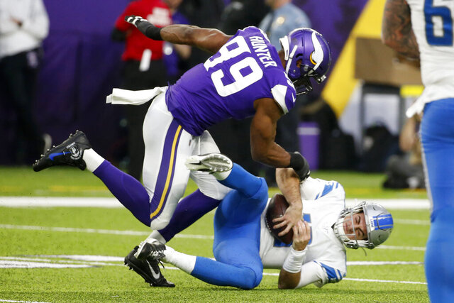 Detroit Lions quarterback David Blough (10) is sacked by Minnesota Vikings defensive end Danielle Hunter (99) during the first half of an NFL football game, Sunday, Dec. 8, 2019, in Minneapolis. (AP Photo/Bruce Kluckhohn)