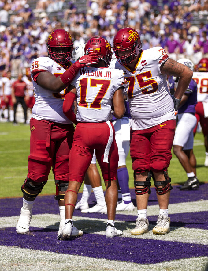 Iowa State wide receiver Darren Wilson Jr. (17) is congratulated by teammates after scoring a touchdown during an NCAA football game against TCU on Saturday, Sept. 26, 2020 in Fort Worth, Texas. (AP Photo/Brandon Wade)