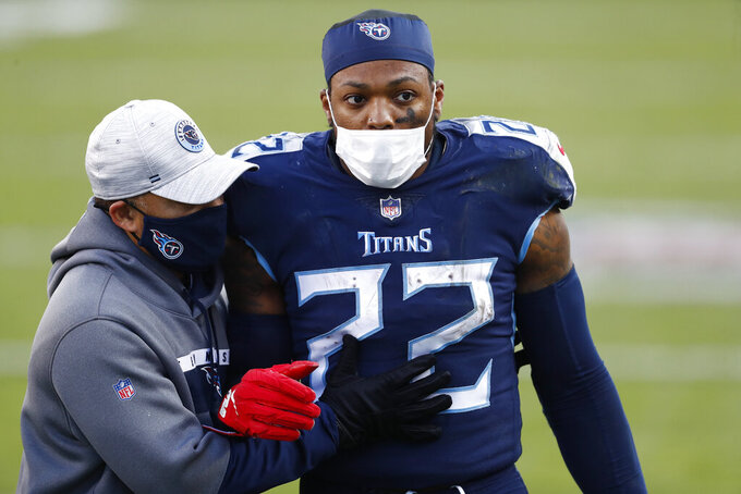 Tennessee Titans running back Derrick Henry (22) leaves the field after the Titans lost to the Baltimore Ravens in an NFL wild-card playoff football game Sunday, Jan. 10, 2021, in Nashville, Tenn. The Ravens won 20-13. (AP Photo/Wade Payne)
