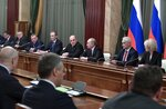 Russian President Vladimir Putin, center right, and new Russian Prime Minister Mikhail Mishustin, center left, attend a new cabinet meeting in Moscow, Russia, Tuesday, Jan. 21, 2020. Putin formed his new Cabinet Tuesday, replacing many of its members but keeping his foreign, defense and finance ministers in place. (Alexei Nikolsky, Sputnik, Kremlin Pool Photo via AP)