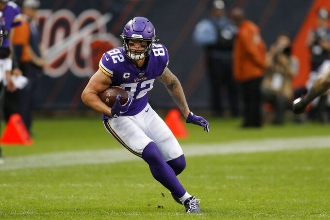 Minnesota Vikings tight end Kyle Rudolph runs with the ball during the second half of an NFL football game against the Chicago Bears Sunday, Sept. 29, 2019, in Chicago. (AP Photo/Charles Rex Arbogast)