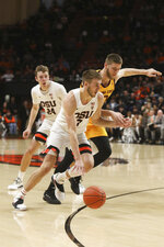 Oregon State's Tres Tinkle (3) tries to outrun Arizona State's Vitaliy Shibel (10) during the first half of an NCAA college basketball game in Corvallis, Ore., Sunday, March 3, 2019. (AP Photo/Amanda Loman)
