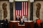 NATO Secretary General Jens Stoltenberg, center, accompanied by Vice President Mike Pence, top left, and House Speaker Nancy Pelosi of Calif., top right, addresses a Joint Meeting of Congress on Capitol Hill in Washington, Wednesday, April 3, 2019, having been invited by the bipartisan leadership of the House of Representatives and the Senate. (AP Photo/Patrick Semansky)