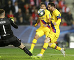Slavia's goalkeeper Ondrej Kolar, left, makes a save in front of Barcelona's Lionel Messi during the Champions League group F soccer match between Slavia Praha and FC Barcelona at the Sinobo stadium in Prague, Czech Republic, Wednesday, Oct. 23, 2019. (AP Photo/Petr David Josek)