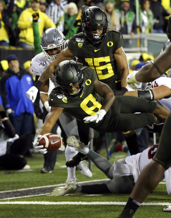 Oregon's Jevon Holland (8) dives into the end zone for a touchdown on an interception against Washington State during the second quarter of an NCAA college football game Saturday, Oct. 26, 2019, in Eugene, Ore. (AP Photo/Chris Pietsch)