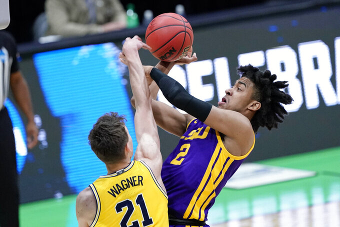 LSU forward Trendon Watford (2) shoots over Michigan guard Franz Wagner (21) during the first half of a second-round game in the NCAA men's college basketball tournament at Lucas Oil Stadium Monday, March 22, 2021, in Indianapolis. (AP Photo/AJ Mast)