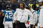 Jacksonville Jaguars heads coach Urban Meyer, center, watches play against the Dallas Cowboys in the first half of a preseason NFL football game in Arlington, Texas, Sunday, Aug. 29, 2021. (AP Photo/Michael Ainsworth)