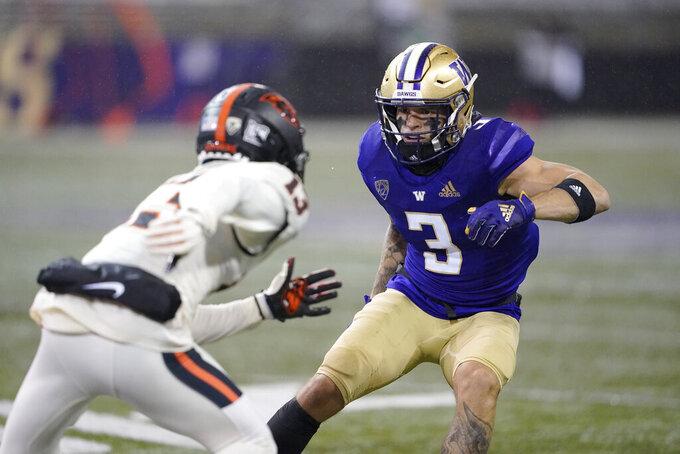 Washington cornerback Elijah Molden (3) covers Oregon State wide receiver Jesiah Irish during the first half of an NCAA college football game, Saturday, Nov. 14, 2020, in Seattle. (AP Photo/Ted S. Warren)