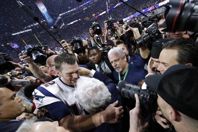 New England Patriots' Tom Brady, left, embraces team owner Robert Kraft after defeating the Los Angeles Rams in the NFL Super Bowl 53 football game, Sunday, Feb. 3, 2019, in Atlanta. The Patriots won 13-3. (AP Photo/David J. Phillip)