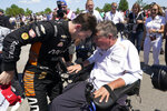 Pato O'Ward celebrates with a team owner Sam Schmidt after winning the second race of the IndyCar Detroit Grand Prix auto racing doubleheader on Belle Isle in Detroit Sunday, June 13, 2021. (AP Photo/Paul Sancya)
