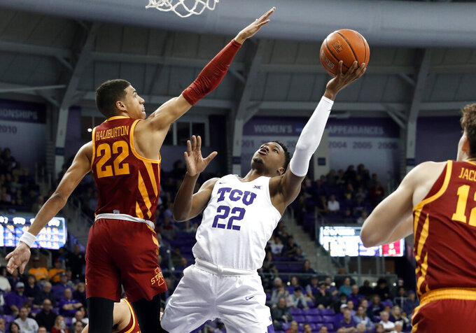 Iowa State guard Tyrese Haliburton (22) and forward Michael Jacobson, right defend against a shot by TCU guard RJ Nembhard (22) in the second half of an NCAA college basketball game in Fort Worth, Texas, Saturday, Feb. 23, 2019. (AP Photo/Tony Gutierrez)