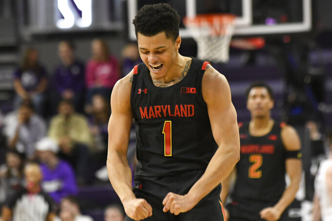Maryland guard Anthony Cowan Jr. (1) gestures after making a three point basket against Northwestern during the second half of an NCAA college basketball game, Tuesday, Jan. 21, 2020, in Evanston, Ill. (AP Photo/David Banks)